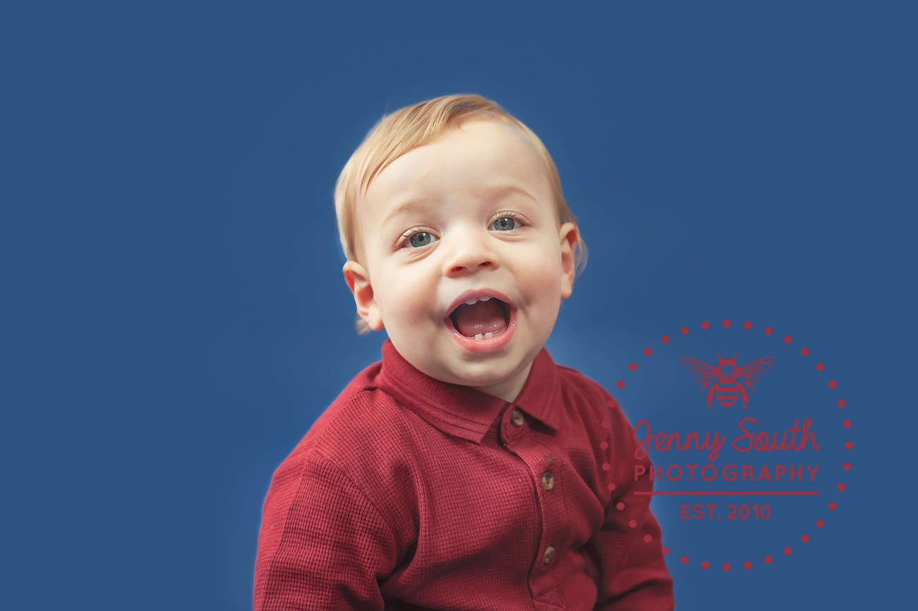Baby smiles during his photo shoot to mark his first birthday