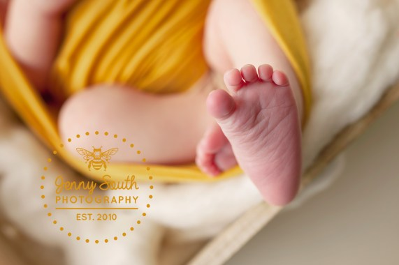 A tiny foot of a newborn baby showing all the little lines and details.