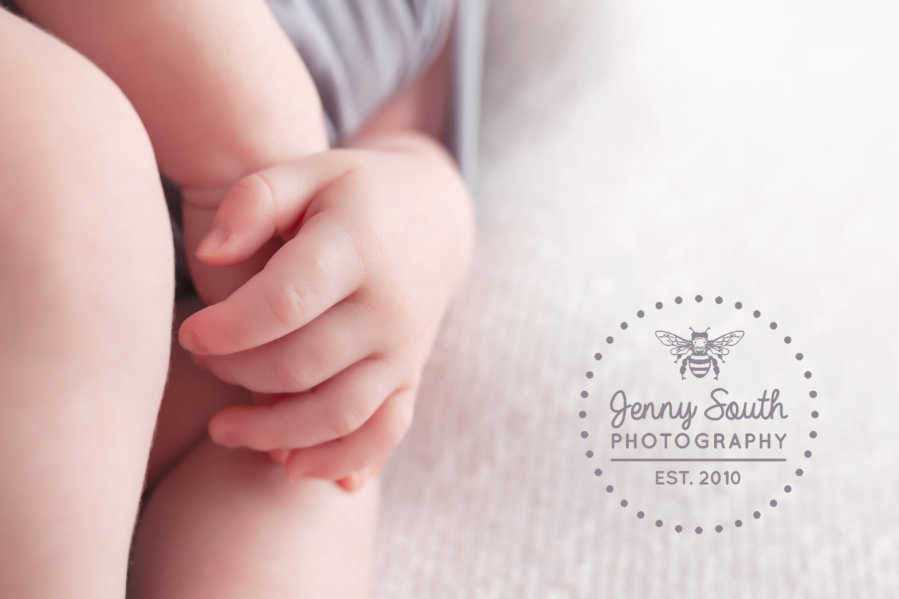 an image of a babies tiny hand against a white backdrop