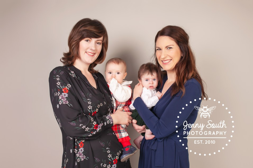 Two mummies cradle their babies during a family photo shoot reuniting them from overseas