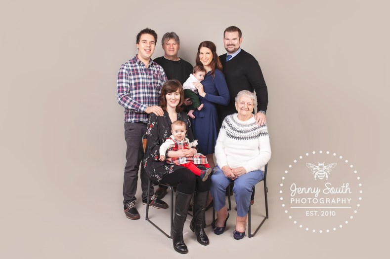 An images of a four generations of family reunited again at Christmas time.