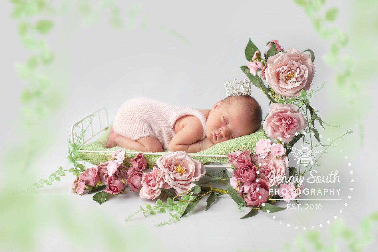 A little girl sleeps soundly like sleeping beauty on a bed of roses.