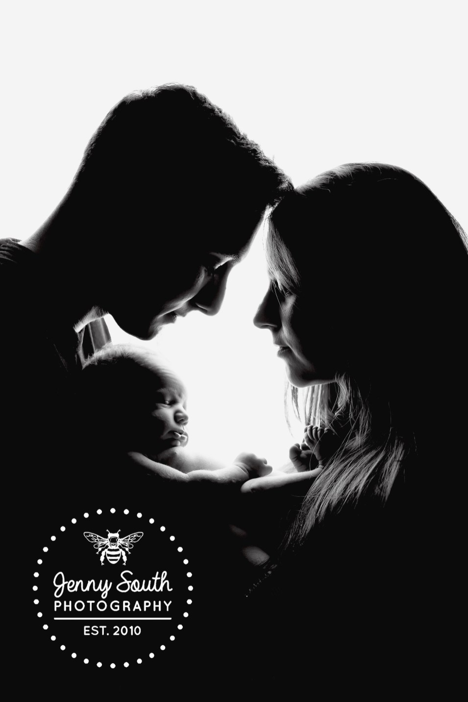 These brand new parents cradle their newborn son during their first family photo session
