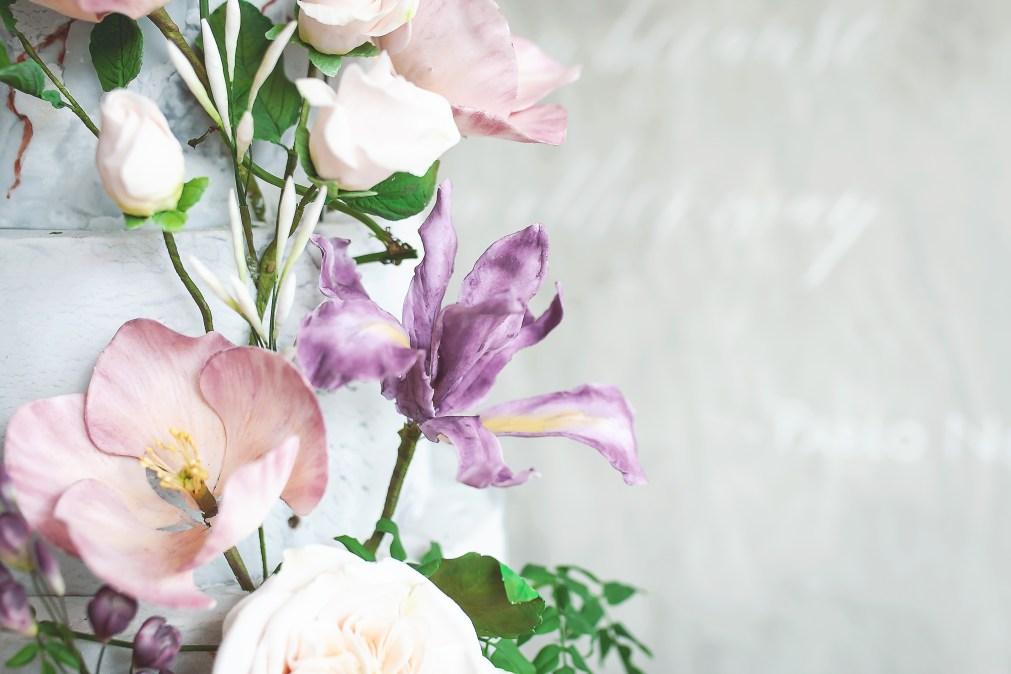 Sugar flowers on a wedding cake created by edible essence