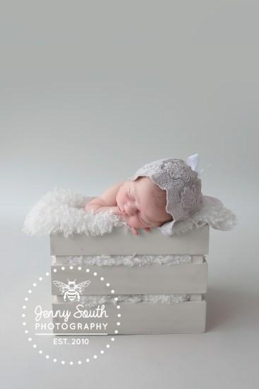 A sophisticated grey newborn session for a beautiful newborn.