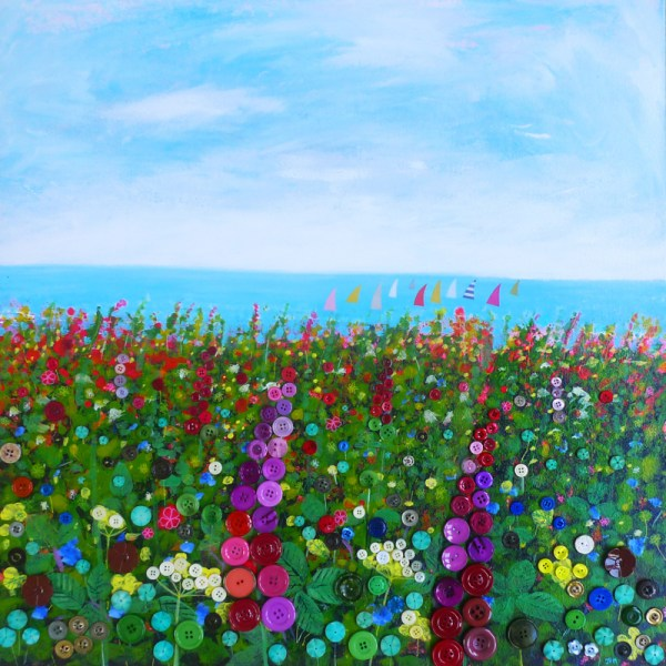 sailing boats in the sea and the cliff covered in wild flowers button by jenny urquhart