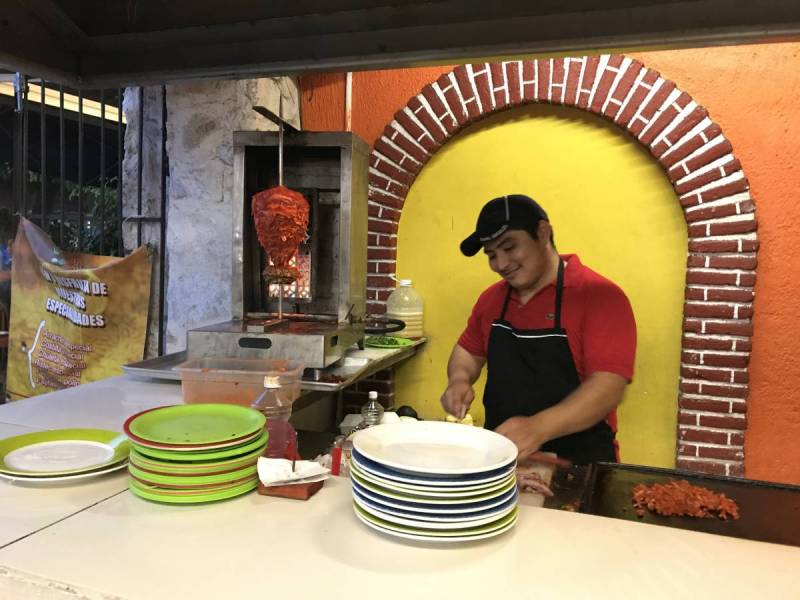 Preparing tacos in a local restaurant