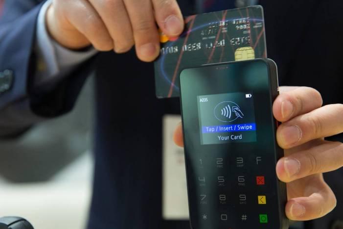 Man swiping a credit card