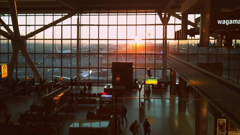 Airport terminal with view of sunset through window