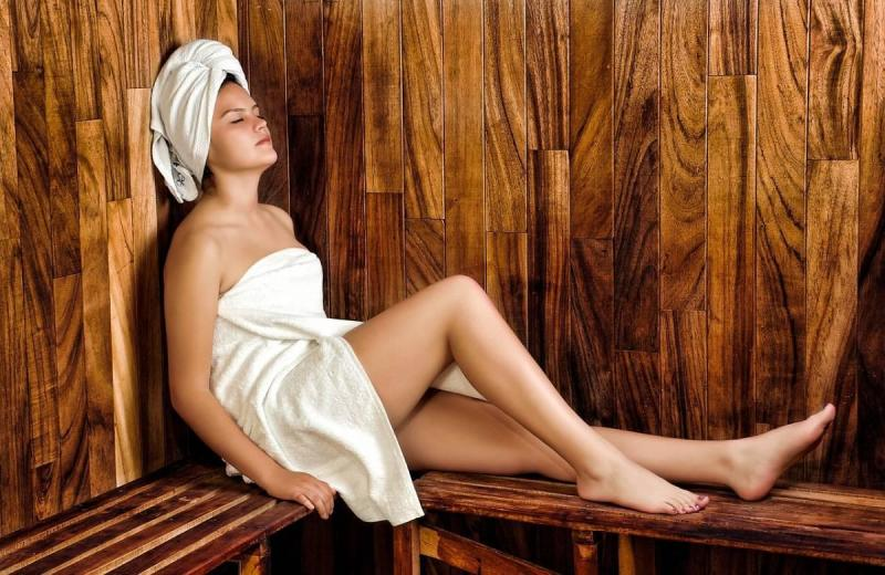 Woman with eyes closed in steam room