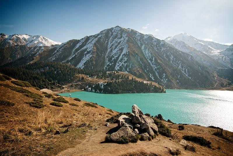 Alpine lake amidst mountains