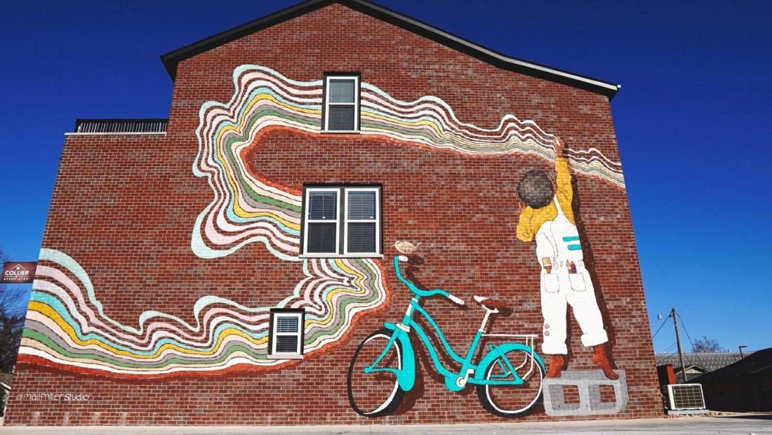 Colorful mural of boy and bike