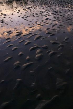 tidal pools reflecting sunsets