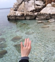 Standing on the rock where we got engaged - my ring is like the color of the sea.
