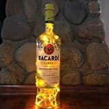 Handmade Beverage Bottle with Yellow LED lights. Great for a desk lamp, a mood light, a man cave, and party. All of our lights are battery operated with replaceable AA batteries. This prevents the lamp from overheating or being a safety risk