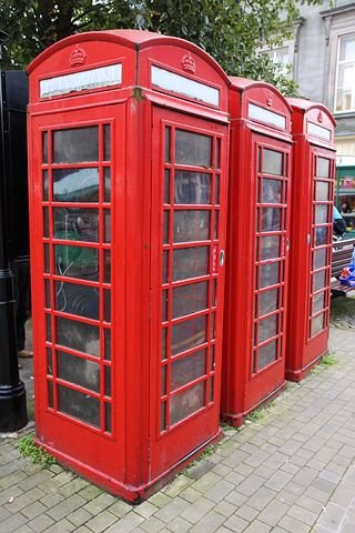 A common sight.  British telephone booth