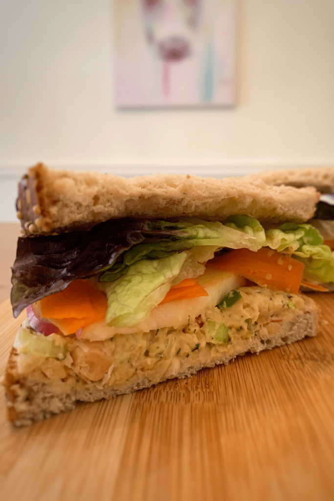 Chicken-Less Chickpea Salad Sandwich with romaine, shaved carrot & sliced apples