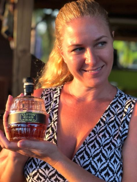 JenThereDoneThat holding a bottle of Clifton Estate Rum
