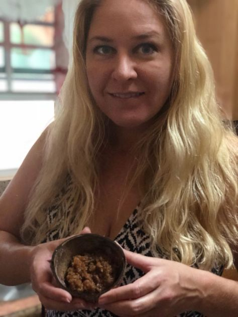 JenThereDoneThat holding fresh made Coconut Sugar Cakes served in coconut shell