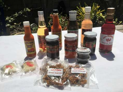 Selection of items from Vals Delights including sugar cakes, jams, jellies, and hot sauce
