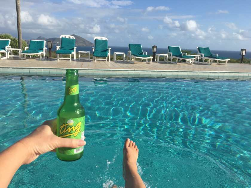 Drinking Ting, the local grapefruit soda, during a morning swim in Mount Nevis hotel pool.