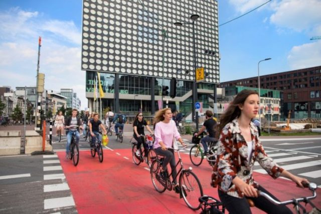 Cyclists cross an intersection near the Central Station of Utrecht, The Netherlands, Aug. 22, 2017. Utrecht is the Netherlands' fastest growing city and also one of the world's most bike-friendly places in one of the world's most bike-friendly countries. (Ilvy Njiokiktjien/The New York Times)
