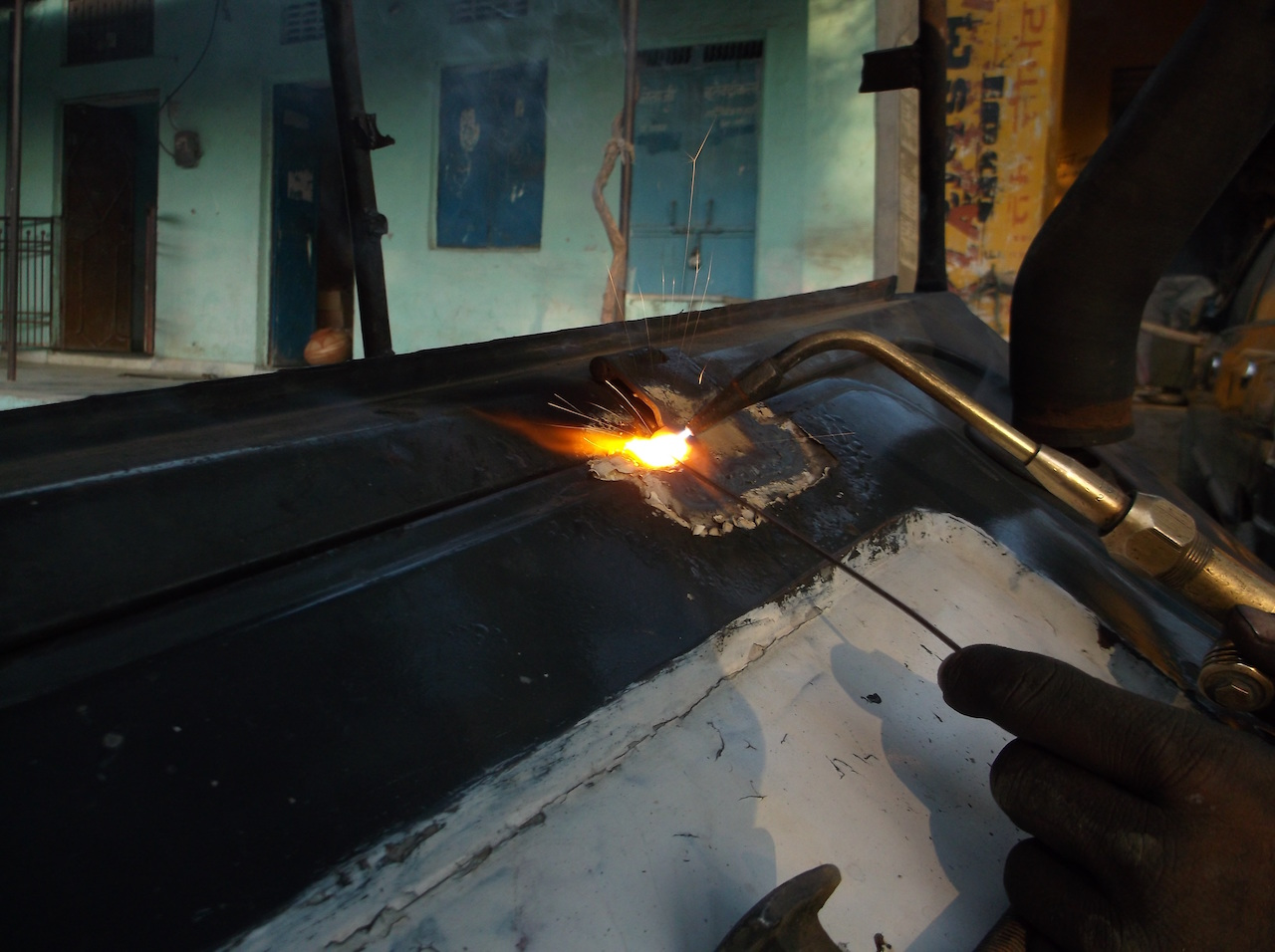 A person welding some metal