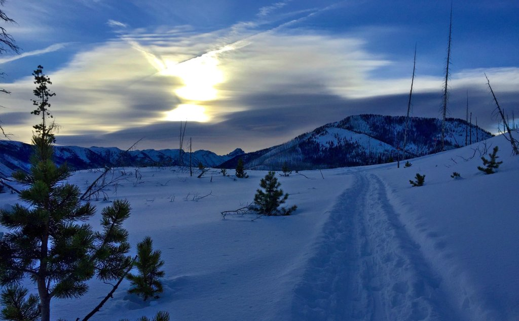 The sun coming up over the trail and mountain tops as we traverse from the Ridge Yurt on to the Boundary Creek Yurt.