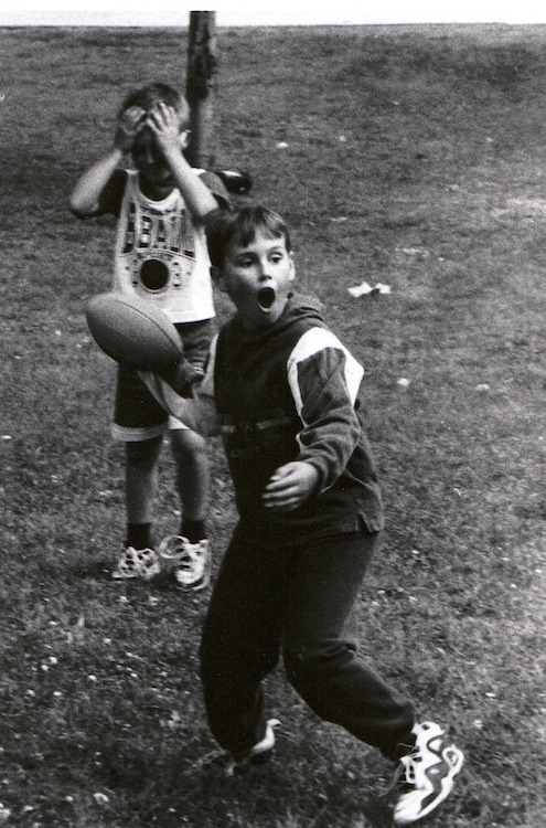 Young football players play a game – from Jeremy Larochelle's photo portfolio.