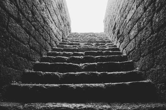 low angle grayscale photo of empty brick stairs