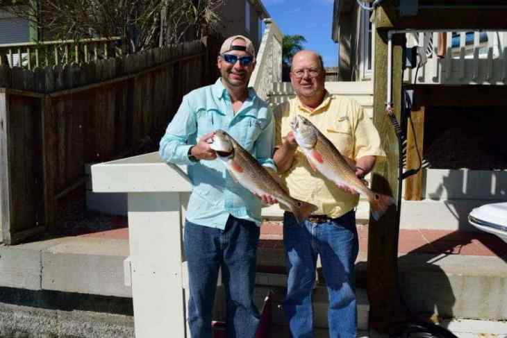 My Dad & I Holding Redfish