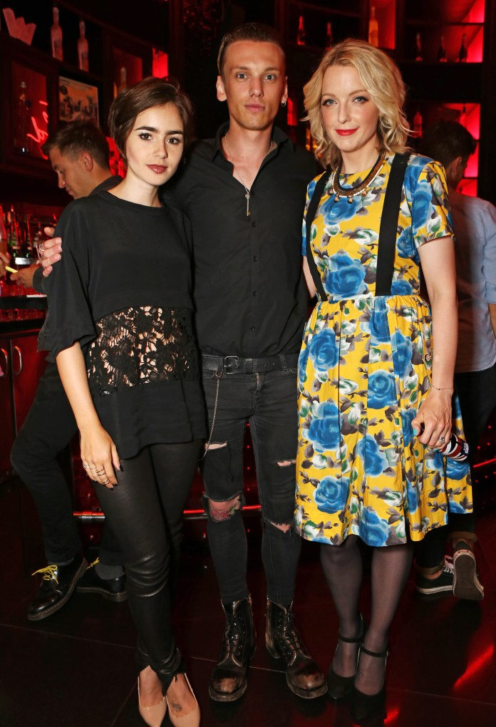 LONDON, ENGLAND - AUGUST 11: (L to R) Lily Collins, Jamie Campbell Bower and Lauren Laverne attend the launch of W London - Leicester Square's Britpop Vinyl Collection curated by DJ Lauren Laverne at W London - Leicester Square on August 11, 2015 in London, England. Pic Credit: Dave Benett