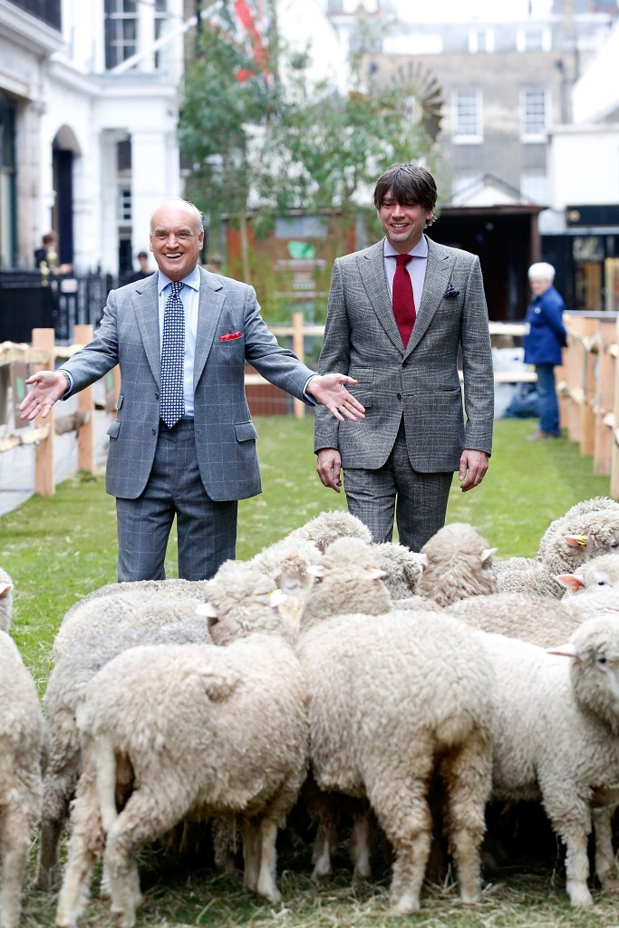 LONDON, ENGLAND - OCTOBER 05: Nicholas Coleridge and Alex James join Bowmont Merino and Exmoor Horn sheep grazing the length of Savile Row to mark the launch of Wool Week 2015 with 'Sheep on the Row' on October 5, 2015 in London, England. (Photo by Tristan Fewings/Getty Images for The Campaign for Wool) *** Local Caption *** Nicholas Coleridge; Alex James