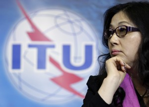 Yafang chairwoman of the board of Huawei listens to a speech before receiving a World Telecommunication and Information Society Award ITU in Geneva