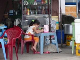 Little girl having dinner