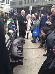 people looking at Homeless Jesus