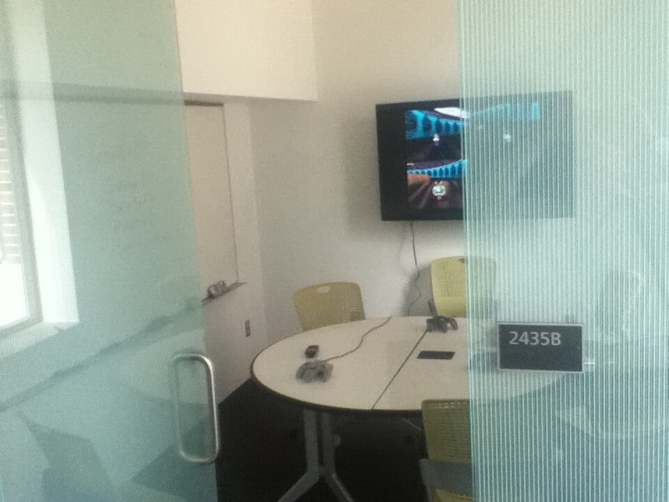 Old-school whiteboards, a reconfigurable table, and a monitor. (This room also had street-level windows.)