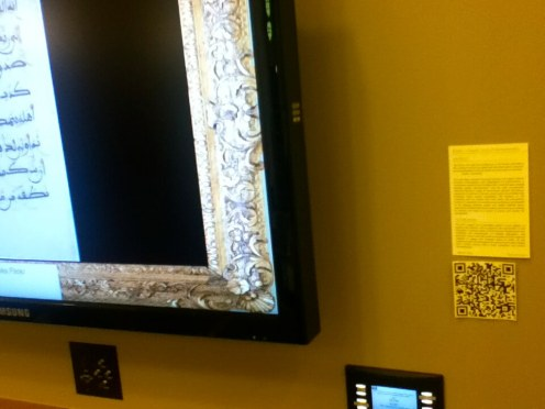 Many of the monitors were labeled like paintings in a museum; this one had a 2d barcode.