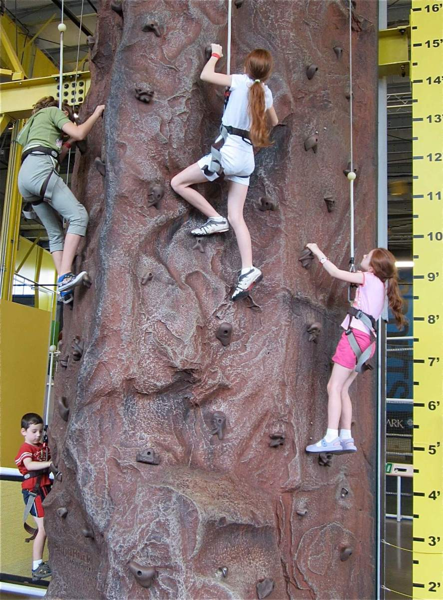 On the rock wall.