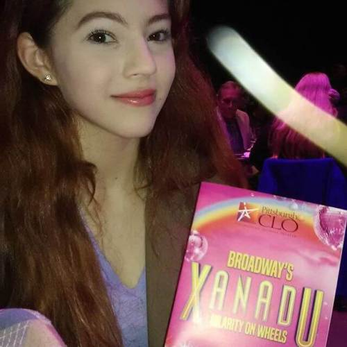 The girl got picked for an audience participation bit as the muse of comedy in Xanadu. Great fun.
