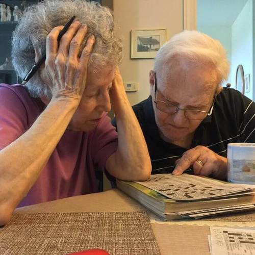 My parents doing their daily crossword puzzle.