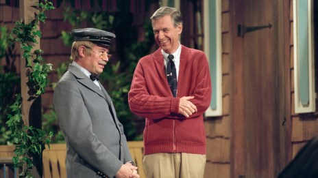 "Picture of Fred Rodgers in his trademark cardigan standing with Mr. McFeeley (portrayed by David Newell) in a still from the PBS TV show ""Mister Rogers' Neighborhood."""