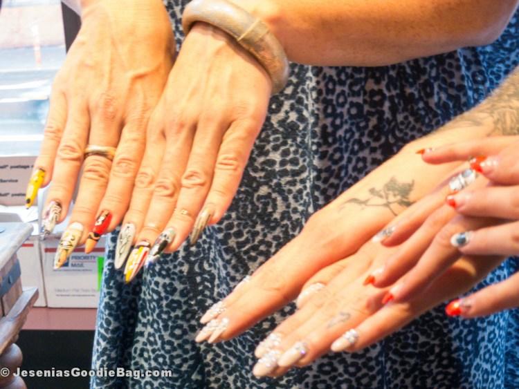 Rita de Alencar Pinto (Vanity Projects) and  Aretha Sack (Floss Gloss) showing off their nail art.