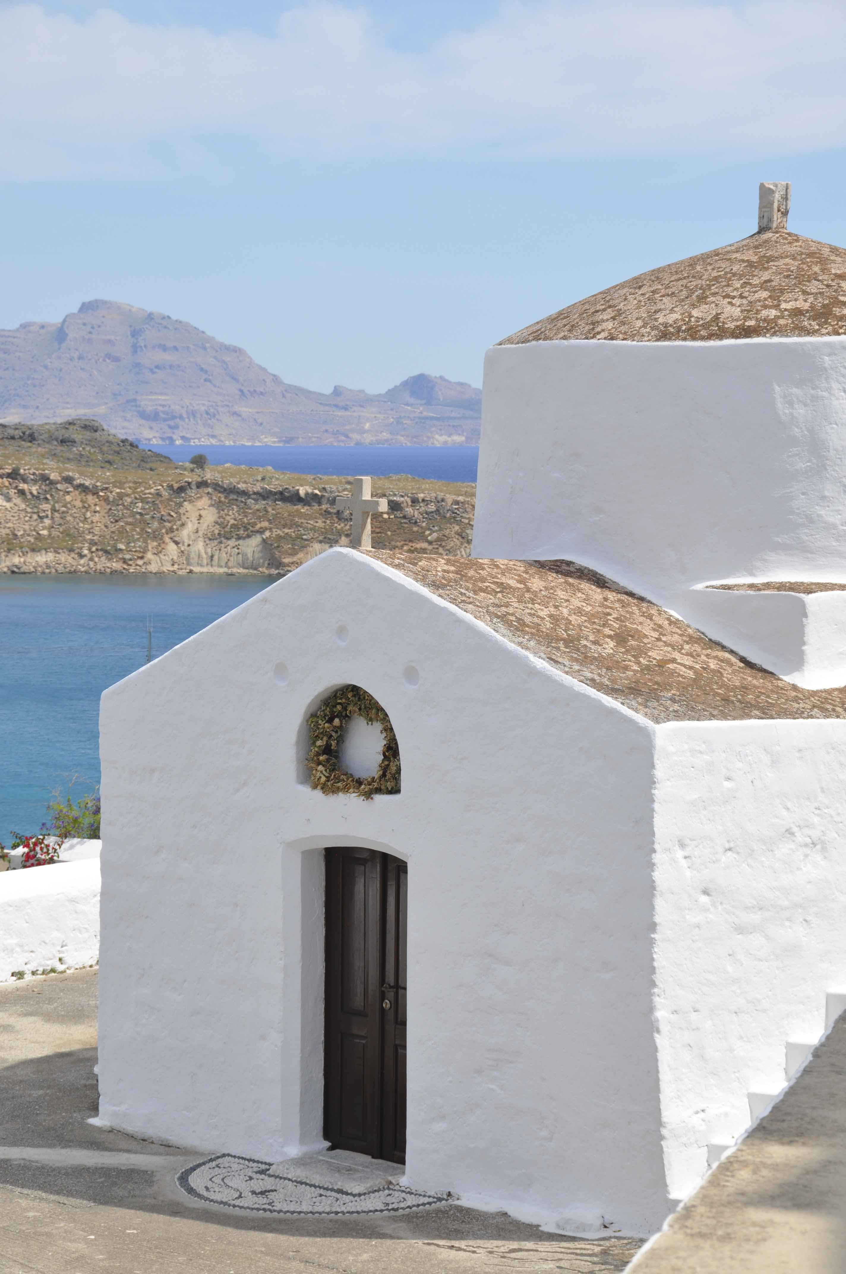 White washed church building by the sea in Lindos - Rhodes - Greece