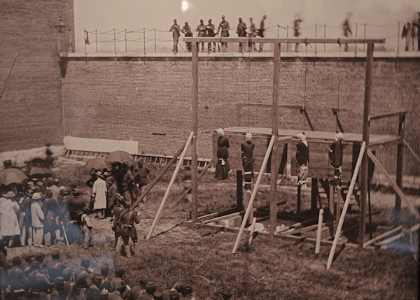 Lincoln conspirators standing on the gallows floor. Maria Suratt on the far left.