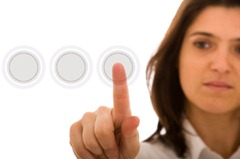 a businesswoman pressing a hi-tech button (you can write your command on the button: login, enter, start, yes, no, ...)