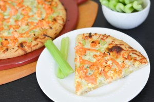 This Buffalo Cauliflower Pizza is perfect for both vegetarians and buffalo chicken lovers! It's topped with all the classic ingredients-- celery, blue cheese and hot sauce-- so you won't even miss the chicken!