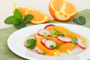 Sweet juicy oranges and crisp spicy radishes are paired together in this fresh Orange and Radish Salad with Mint. It's simple but unique and so delicious!