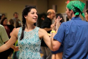 Hannah Fakoury and Troy Thieszen allemande during a partner swap of one dance.