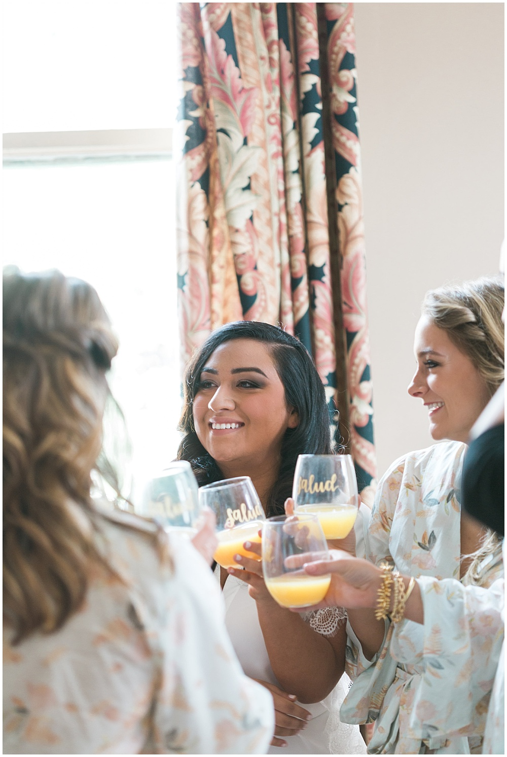 bride and bridesmaids getting ready; floral robes; Mexican inspired gold & floral wedding; Crowne Plaza Indianapolis Downtown Union Station; neutral floral and greenery wedding|Cory + Jackie and Jessica Dum Wedding Coordination